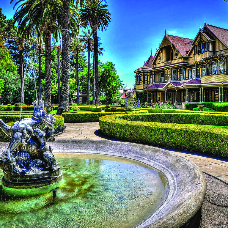 A view of the Winchester Mystery House from the beautifully manicured garden.