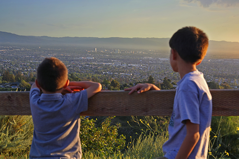 kids on a hiking trail overlooking the valley in Alum Rock Park