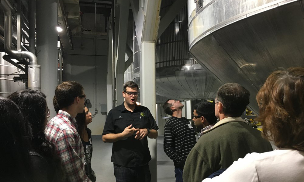 people taking a tour of the Gordon Biersch brewing facility