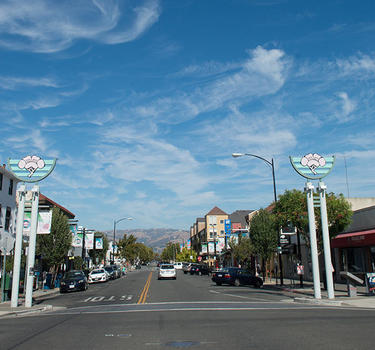 An image looking down Jackson Street, the main drag of Japantown, with the rolling east foothills in the background