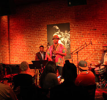A 3-piece Jazz band performing for a full house at Cafe Stritch