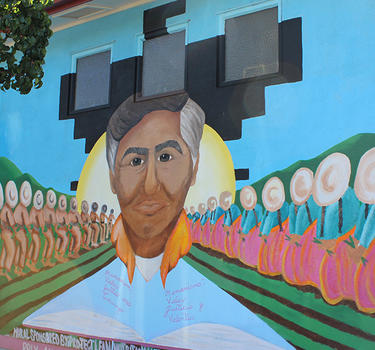 A mural of Cesar Chavez across from the community center.