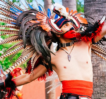 Aztec dancer performing at the Mexican Heritage Plaza