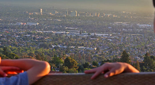 Image with two boys looking down on Downtown San Jose and the entire Silicon Valley from a trailhead at Alum Rock Park