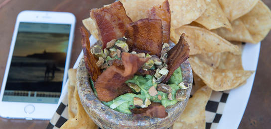 Zona Rosa's thick slices of bacon sticking out of a giant bowl of guacamole garnished with pastachios.