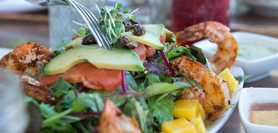 A prawn and avacado salad with housemade flavored lemonades at Zona Rosa.