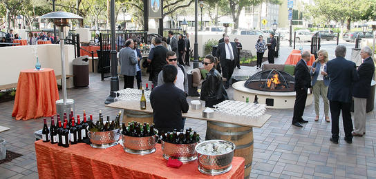 A reception on the outdoor patio of the City National Civic