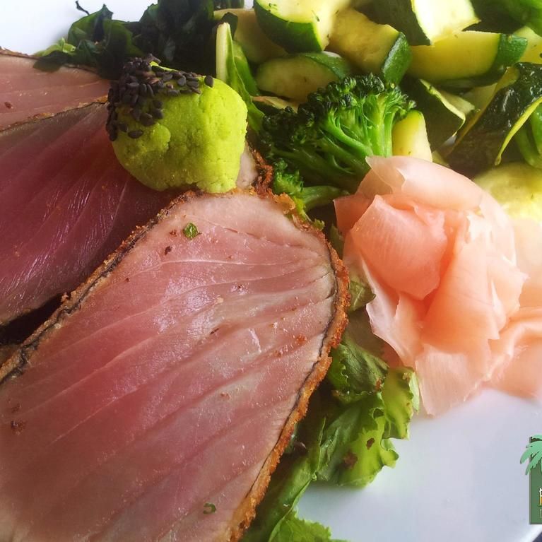 slices of meat and broccoli