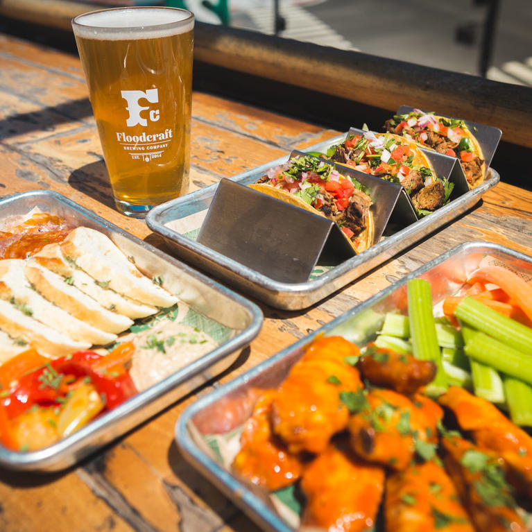 trays of food and glass of beer