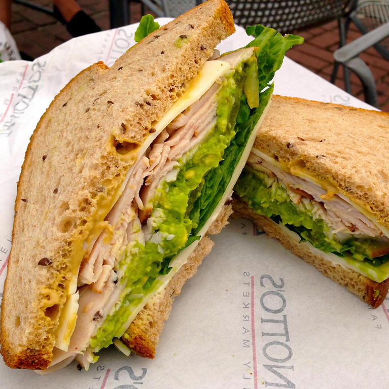 Turkey sandwich with avocado.