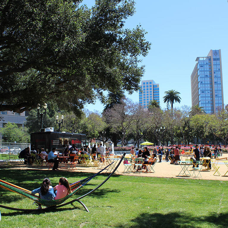Families enjoy a warm summer day with food truck at Cesar Chavez Park