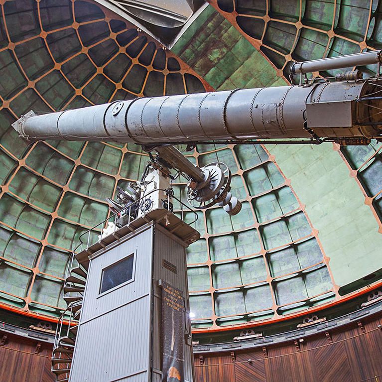 Visitors look up at the main refractor in the big dome at Lick Observatory on Mount Hamilton