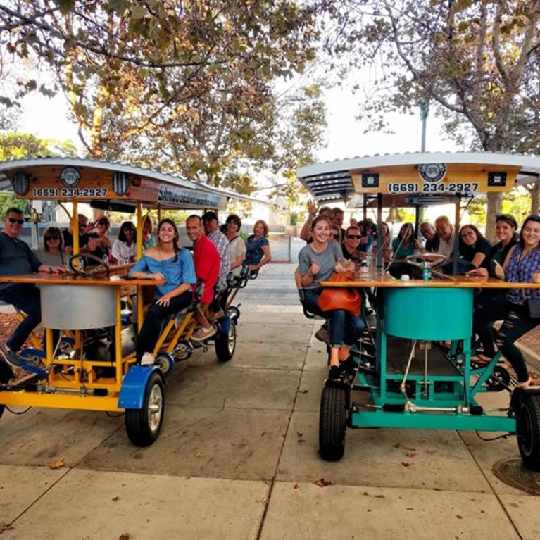 Friends enjoy San Jose Brew Bike, travelling from brewery to various businesses.
