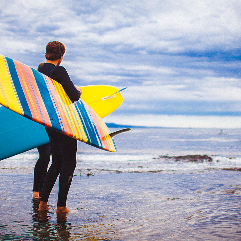 Man Holding Surfboards