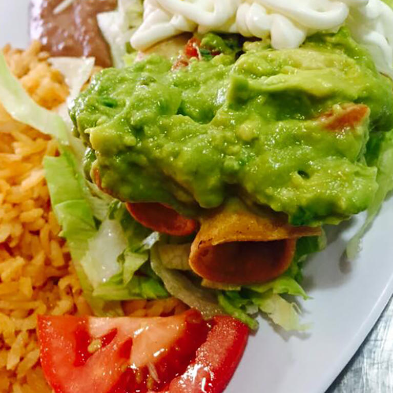 Flautas with guacamole at El Pirrin