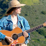 Grace Kelly strums her guitar in the East Foothills of San Jose