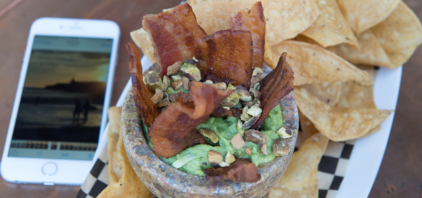 thick bacon slices in pastachio guacamole